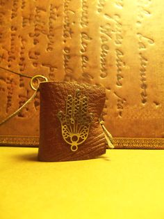 Lucky charm mini leather book pendant Facebook page:Handmade Leather Mini-Book Pendants