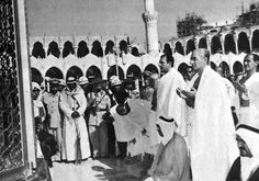 Mohammad Reza Shah praying in Mecca next to Ardeshir Zahedi Iran's ambassador to Washington. 1970's.