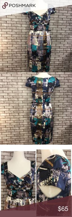 David Meister Dress This is a beautiful dress !!! Fitted pencil dress with matching belt, beautiful cap sleeves, on the inside of both sleeves there is some pulling as pictured in the last post. 100% silk, dry clean only. David Meister Dresses Midi