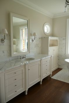 Steve Giannetti used a marble slab in this master bathroom and then tiled the walls in the Carrara subway size. Next, he used tiny mosaic sized marble to create a mat underneath the bathtub! (From Cote De Texas: White Marble for the Kitchen, Yes or No? Marble Bathroom Floor, Cream Bathroom, Bathroom Cabinets, Bathroom Flooring, White Bathrooms, Marble Floor, Marble Bathrooms, Vanity Bathroom, Hall Bathroom