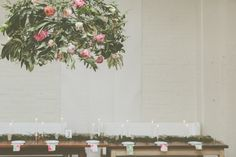 Industrial Wedding styled by All The Frills, photo by Lene Photography. www.allthefrills.co.nz | floral chandelier and tablescape