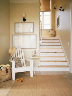 This back entry gets a style boost from its outdoors-in decor. A dirt-friendly sisal carpet, painted Adirondack chair, wrought-iron side table, framed maps and sandy wall color add to the beachy outdoor feel.
