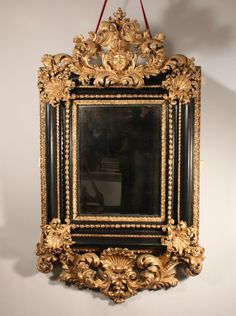 Beautiful #mirror in carved dark and #gilded #wood, made in #Italy around #1700. For sale on Proantic by Galerie Pellat de Villedon.