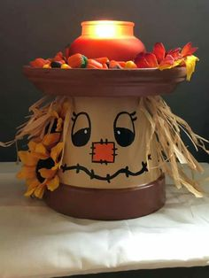 Scarecrow dish , made with terra cotta pots Clay Pot Projects, Clay Pot Crafts, Fall Projects, Clay Flower Pots, Flower Pot Crafts, Painted Clay Pots, Painted Flower Pots, Thanksgiving Crafts, Fall Crafts