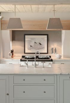 Contemporary - straight lines +soft colors +light wood + Shaker style cabinets+ marble countertops