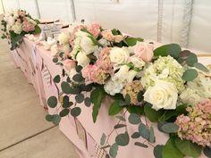 Love this eucalyptus infused blush and cream head table centerpiece #FurstEvents #daytonweddings