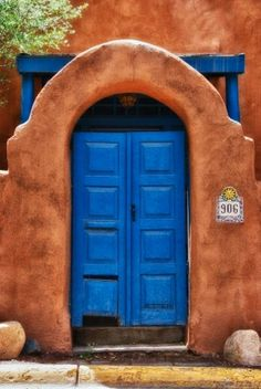 906 Canyon Road, Santa Fe, New Mexico. This house was for sale recently. A bit out of my price range. New Mexico Style, New Mexico Homes, Adobe House, Santa Fe Style, Southwest Style, Southwestern Doors, Land Of Enchantment, Mexican Style, Painted Doors