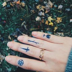 These tiny markings refer to the Minor Arcana of the Tarot deck: pentacles, swords, wands, and cups. | 19 Powerful Tarot Tattoos