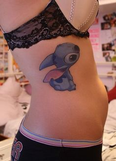 Stitch tattoo on the side. Adorable.