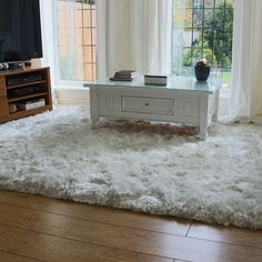 Snow white soft polyester fibres with silky lustrous sheen. High quality shaggy plush rug – Hand woven in India. Extremely thick pile that is very dense and fluffy soft. Water resistent, moth and mildew proof. 6 sizes from £93.50 http://www.landofrugs.com/rugs/shaggy/white-ultra-thick-plush-shaggy-rug.html
