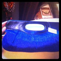 Host PickElectric Blue Sparkle Clutch Clutch is sparkly blue as seen in the third pic. with black leather handle!  Inside has a nice amount of storage and an inside zip as well. Classy!!!  I have this in black also! Bags Clutches & Wristlets