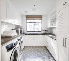A white and gray laundry room clad in black and white mosaic floor tiles boasting a gift wrapping station fixed over white shaker cabinets donning chrome pulls and a dark gray quartz countertop. A white and gray laundry room clad in black Grey Laundry Rooms, Farmhouse Laundry Room, Laundry Room Design, Laundry Area, Kitchen Design, White Shaker Cabinets, Gray Cabinets, Laundry Room Remodel, Laundry Room Inspiration