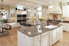 Traditional Kitchen with Ms International Giallo Rio Granite, Breakfast bar, Dura supreme cabinetry mullion pattern #1