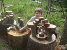 """Kenan also cut a ton of natural wood blocks for the kids. They had a great time building fairy houses and structures and kingdoms and knocking them down again. Ours are really roughly cut (husband used a chain saw), we didn't sand them or seal them or anything. It is truly amazing to see their imaginations at work."""