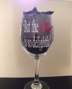 But the WINE is so delightful - Holiday Wine Glass on Etsy, $12.00