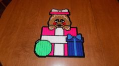 Gingerbread in present wall hanging by TmSalesCreations on Etsy