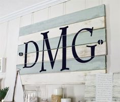 Simple Vinyl Monogram applied to distressed wood boards.  #DIY #vinyl