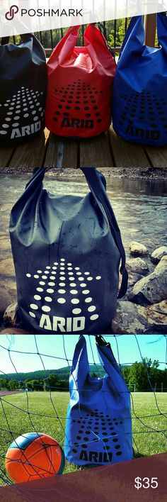 Waterproof Sports Bag Roll top bag/ backpack. Large 55L. Great to keep all your gear dry! Roll top down 3 times and buckle to create the carrying handle. Shoulder strap included. Large enough to keep a soccer bag with ball inside.   RED, BLACK and BLUE bags available. PLEASE SPECIFY COLOR WHEN ORDERING. Thank you :) ARID Bags Backpacks