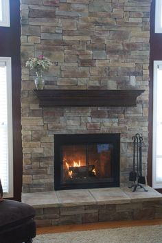 Fireplace makeover- stone over brick