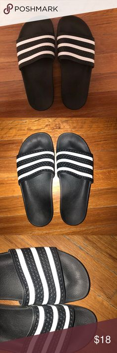 buy popular 8790d 20800 Adidas Adilette Black and White Slides 8 Worn a few times but no sign of  wear. Men s size women s size Black and white adidas Shoes Slippers
