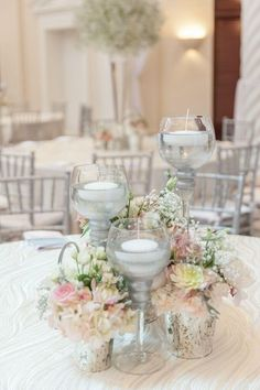 candle and flower centerpiece ~  we ❤ this! moncheribridals.com #weddingcandlecenterpiece