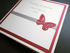 Butterfly theme wedding stationery with a burgundy colour scheme