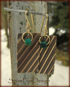Cubed and Corrugated Chrysocolla and Brass Earrings  Patina-ed Brass plates have been corrugated on an angle and brushed by hand then ornamented with a single blue/green Chrysocolla cube. Hand crafted Brass ear wires. Very lightweight.
