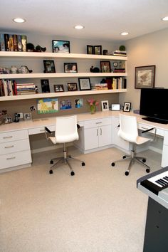 L-shaped desk/table top and wall-to-wall shelving - great for craft room/office combo