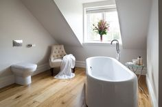 Little Luxury: 30 Bathrooms That Delight with a Side Table for the Bathtub