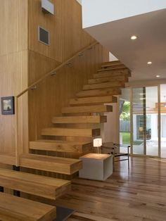 floating wood stairs designs: floating stairs with massive wooden stairs Staircase Wall Decor, Wood Staircase, Floating Staircase, Wooden Stairs, Modern Staircase, Staircase Design, Stair Design, Staircase Ideas, Banister Ideas