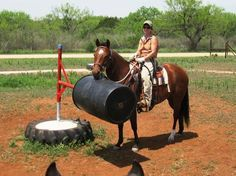 This is one of the smartest things I've seen someone set up. A barrel that can be pushed around by the horse.
