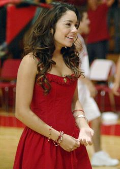 Pin for Later: Relive Your Childhood With These Nostalgic Disney Channel Halloween Costumes Gabriella Montez From High School Musical  What to wear: A simple red dress with your hair done in loose curls. How to act: Sweet and bubbly, like the typical girl next door.