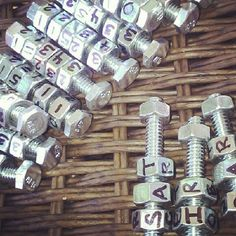 Put nuts on a bolt with letters and numbers. Line up the letters to spell a word and read off the numbers for the waypoint.