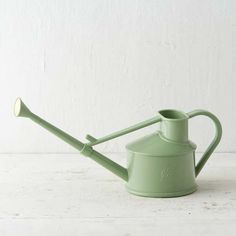 Made in England by Haws and based on their original 1886 design, with a traditional brass rose for slow-flow watering. | Mini Heirloom Watering Can from @shopterrain