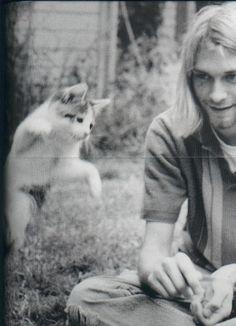 Kurt Cobain, enjoying the moment with kitty.