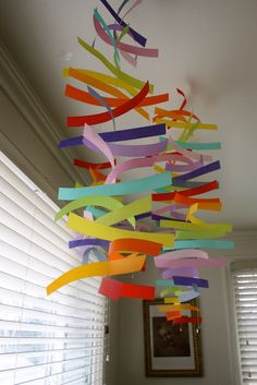 Vellum mobiles (for the girls' rainbow room)  directions here: http://www.projectwedding.com/wedding-ideas/diy-modern-colorful-mobiles