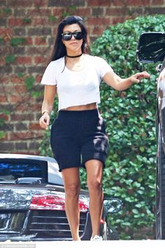 Fit as a fiddle: Kourtney Kardashian was certainly the yummy mummy as dropped her adorable one-year-old son Reign off at class in Beverly Hills