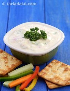 This refreshing Yoghurt Paneer Dip is made of fresh cool curds with soft paneer, onion and other appropriate ingredients. The chopped celery adds to the aroma and flavour of this dip, and makes it a great accompaniment for crackers and crispy and crunchy veggies!