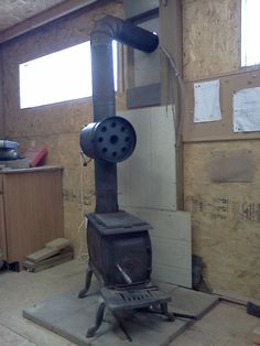 I wanted to build this heat exchanger to reclaim some of the heat that is lost up the chimney of my wood stove. I use the wood stove to heat my. Fireplace Mortar, Stove Fireplace, Antique Wood Stove, How To Antique Wood, Wood Stove Heater, Diy Wood Stove, Rocket Mass Heater, Kerosene Heater, Welding Projects