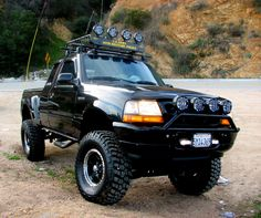 Ford Ranger Lifted with night time lights.