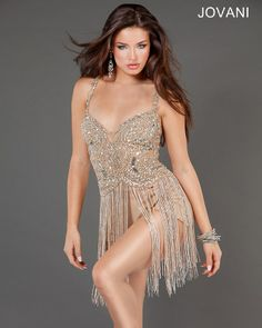 Super sexy Jovani mini gold dress features beautiful beaded embroidery on the top bodice and a beaded fringe skirt over a jersey nude underlay. A perfect club dress. Style, 73900