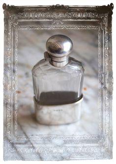 a tried & true hip flask. vintage silver & glass.