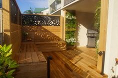 H&G Vertical Gardens - modern - deck - brisbane - by Hailey - like vertical garden, table between seats and metal sculpture