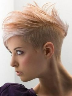 Messy side swept style with half shaven sides