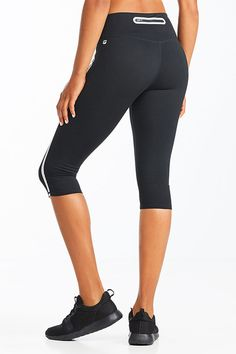 Stripe right in our moisture-wicking, compression crop with bonded silver tape down the leg. A convenient back zipper will store your card during your cardio session, and chafe-free stitching will keep you feeling good from start to finish.