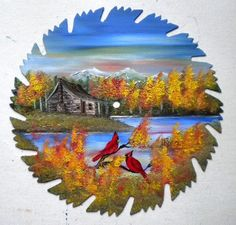 beautiful fall scene with cardinals painted on a saw blade