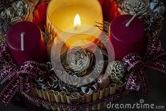 Christmas mood, advent wreath, lit candle, burgundy colors