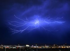 Lightning strikes during a thunderstorm in Las Vegas, Nevada. The monsoon storm dropped heavy rain and hail in parts of the valley causing street flooding and power outages. Ethan Miller / Getty Images  22 Of The Most Powerful Photos Of This Week