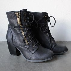 RESTOCKING!!! PLEASE SIGN UP FOR EMAIL NOTIFICATION. :D Stylish ankle boots that features a side zip, laced up front, and stacked heel. man made material import