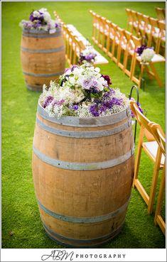 wine barrels, wine theme, wedding aisle